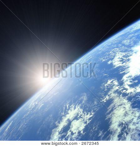 Tierra con el sol naciente