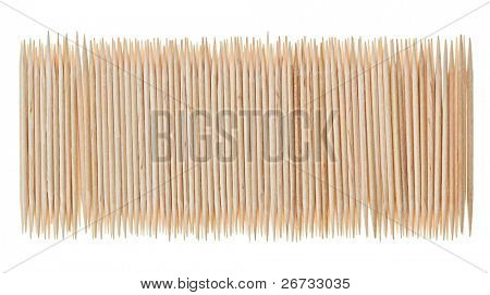 Many scattered toothpicks in paling shape, isolated on white