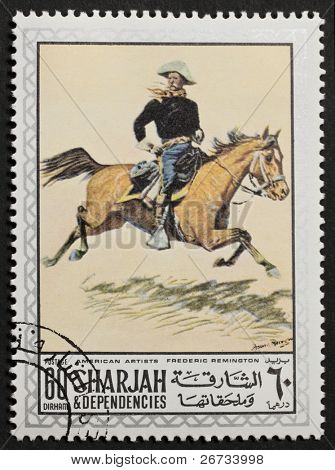 SHARJAH (UAE) - CIRCA 1969: a stamp printed in Sharjah (Emirate) shows a picture of a union horseman painted by Frederic Remington. Sharjah, circa 1969