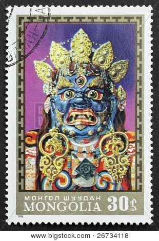 MONGOLIA - CIRCA 1971: a stamp printed in Mongolia shows image of a Buddhist ritual mask, Mongolia, circa 1971