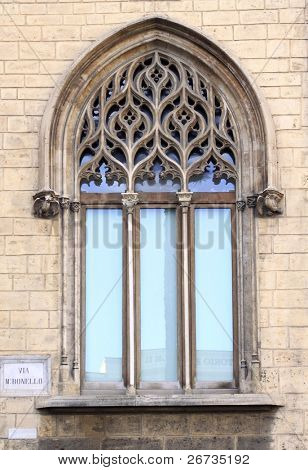 Refined three-light Gothic-Catalan window. Archbishop's palace in Palermo, Italy