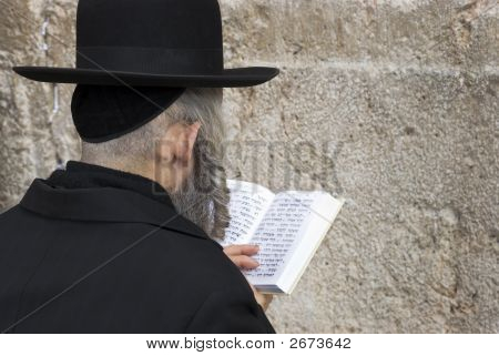 Man Prays At Western Wall