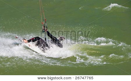 kite boarding on a beach of sea, sportsmen in action