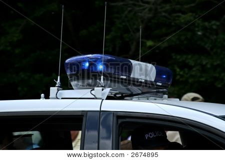 Police Car Siren On Top Of Police Car As It Passes By