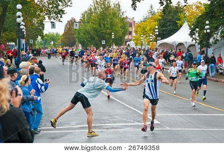 VICTORIA, BC, CANADA - OCTOBER 10: Runners compete at the GoodLife Fitness Victoria Marathon October 10, 2010 in Victoria, BC, Canada.