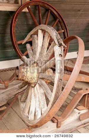 An old broken wagon wheel.
