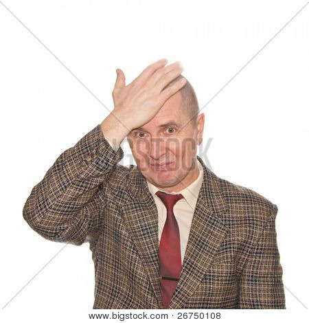A businessman smacking his forehead. Isolated on white. Body language. Disappointment. Self-accusation.