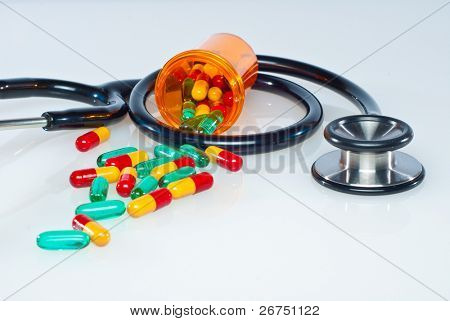 medical concept with colorful pills and stethoscope