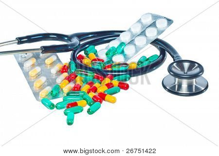medical concept with colorful pills and stethoscope isolated on white background.