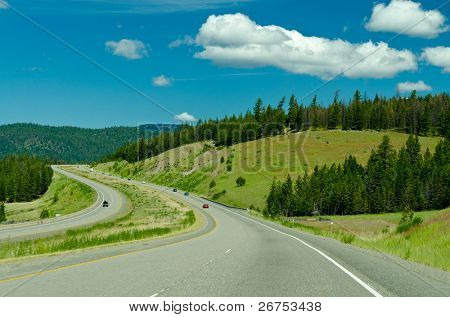 Picture of a countryside road over nice mountain and blue sky