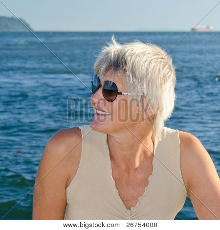Beautiful woman at the rock beach in Vancouver, Canada.
