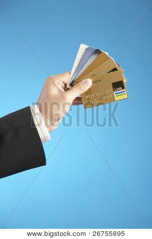 man holding numerous credit cards