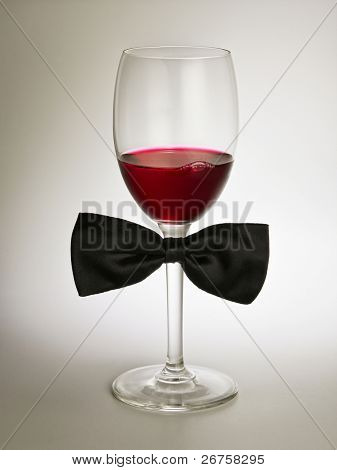 red wine glass with bow tie