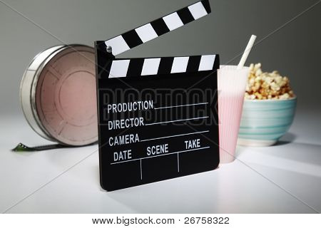 clapperboard in front of the film reel and others