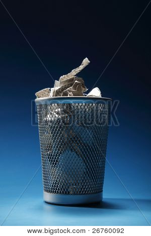 trash bin  on the blue background