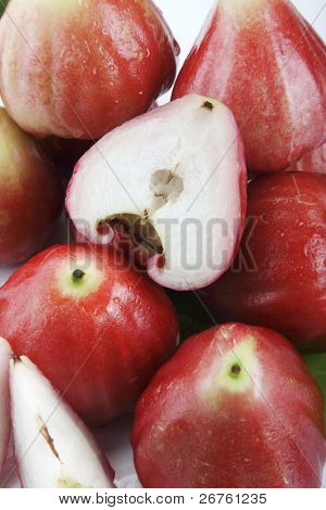 The red Java apples on the plain background