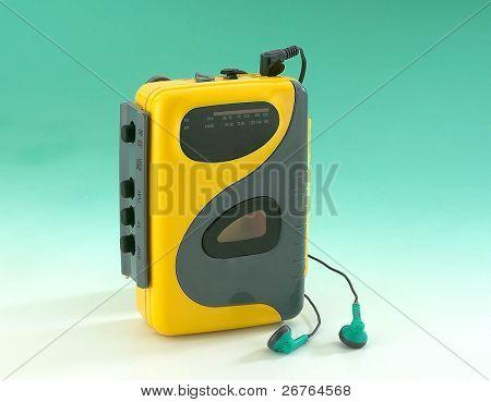 old Walkman on green background