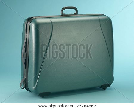 suitcase isolated on a blue background