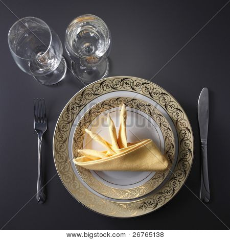 table setting for fine dining or party. cutlery and plate set up for wedding celebration
