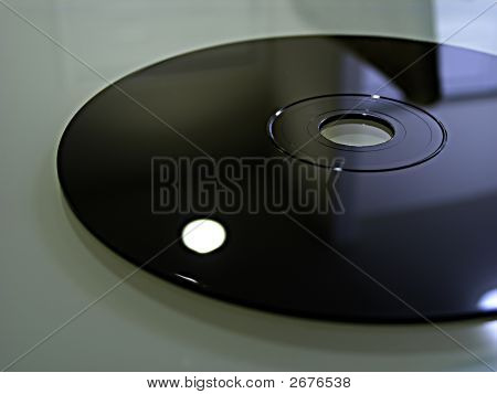 Macro Shot Of Compact Disk On Glass Surface