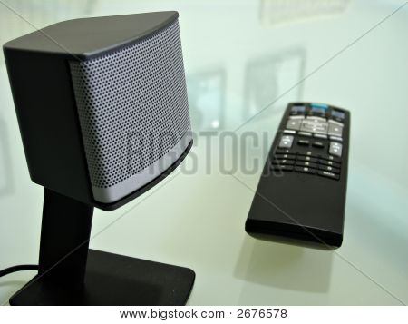 Close Up Of Speaker And Tv Remote Control