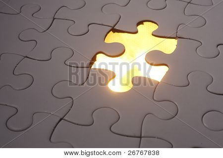 Jigsaw puzzle placed over light.