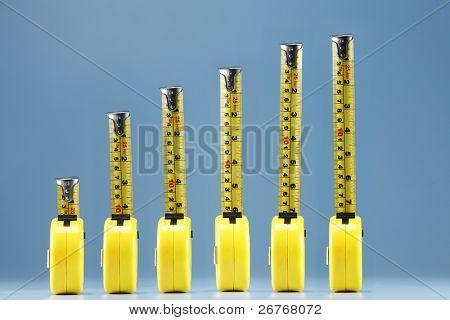 Multiple tape measures arranged together