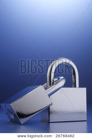Two padlocks interlocked together on the background.