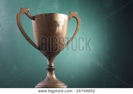 Trophy cup isolated on the green board