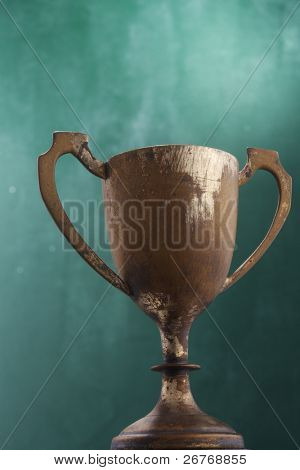 Bronze trophy isolated on the green background.