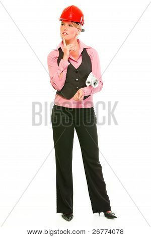 Full Length Portrait Of Thoughtful Modern Architect Woman With Flipcharts In Hands