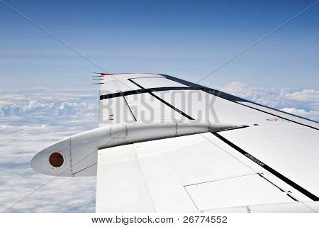 Flying above the clouds on the passenger jet