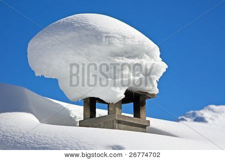 Winter view: Chimney shaft covered with snow