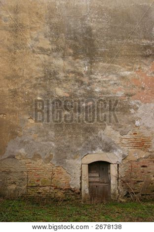 Tiny Backdoor And Facade Of An Old Abandoned Building