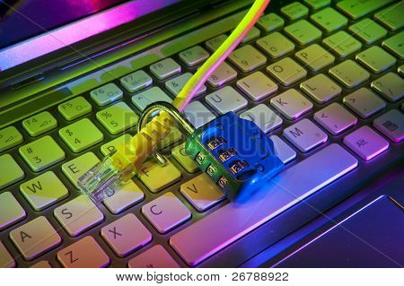 Lock and network cable with computer keyboard background