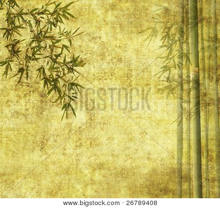 bamboo leaves on old grunge antique paper texture