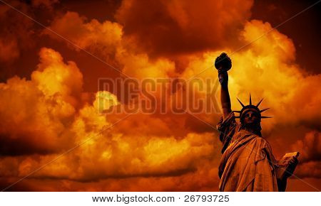 The Statue of Liberty by sunset in New York, USA