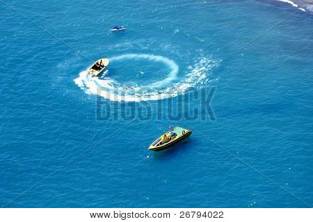 elevated view of jetski and  boats on sea