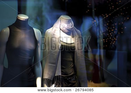 close up boutique display window with mannequins