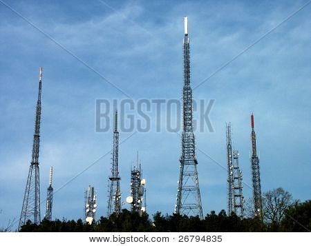 an image of metal broadcast tower with blue sky