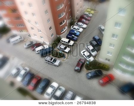elevated view of parked cars in parking lot