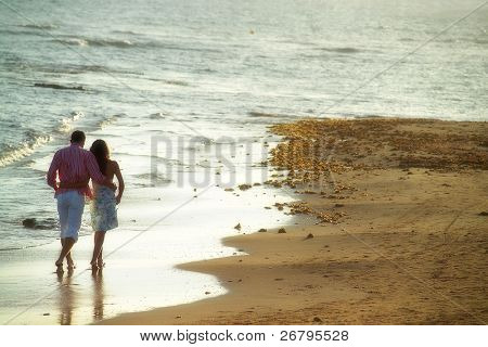 close up shot of attractive couple walking at the beach