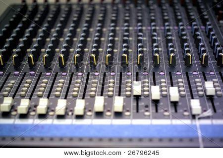 close up shot of an sound mixer buttons