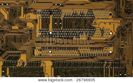 close up shot of a yellow computer circuitboard