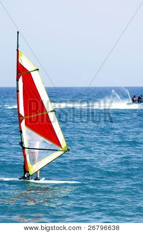 an image of a man windsurfing on summer time