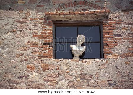 an image of statue by the window