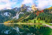 Beautiful View Of Idyllic Colorful Autumn Scenery With Dachstein Mountain Summit By Gosausee Mountai poster