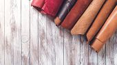 Multi Colored Leather In Rolls. Flat Lay. Rolls Of Natural Color Leather. Materials For Leather Craf poster