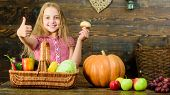 Child Girl Presenting Harvest Of Her Vegetable Garden On Wooden Background. Kid Girl Spend Childhood poster