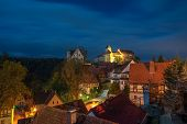 Scenic Night Scape Of Hohnstein Town With Hohnstein Castle And Neat Timber Framing Houses In Saxon S poster